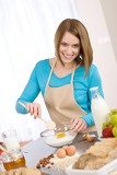 Baking - Smiling woman with healthy ingredients