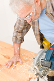 Photo Home improvement - handyman cut wood with jigsaw
