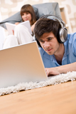 Fotografie Student - Two teenager with laptop and headphones