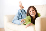 Cheerful woman switch television in living room