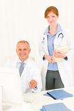 Fotografie Medical doctor team senior male young woman