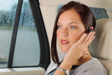 Executive businesswoman luxury car call hands-free