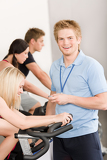 Young fitness instructor gym people spinning