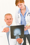 Medical team doctors look at head x-ray