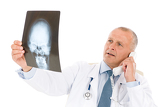 Mature senior doctor male look at x-ray
