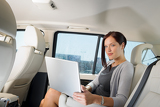 Fotografie Executive businesswoman work laptop car backseat