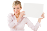 Happy businesswoman holding up empty banner