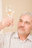 Fotografie Senior mature man with glass of white wine