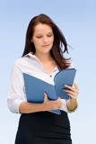 Fotografie Businesswoman in sunny nature looking into folders