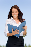 Fotografie Businesswoman in sunny nature smiling hold folders