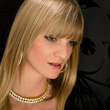 Glamorous blond woman party dress jewelry portrait