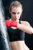 Boxing training blond woman sparring