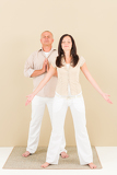 Casual business yoga pose businesspeople standing