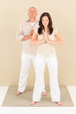 Fotografie Casual business yoga pose businesspeople standing