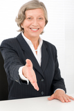 Fotografie Senior businesswoman handshake close deal smiling