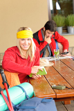 Fotografie Tramping young couple relax by wooden table
