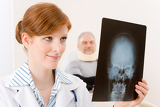 Doctor office - female physician x-ray patient