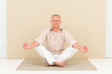 Casual business yoga smiling senior man meditate