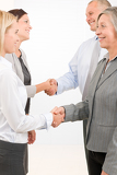 Fotografie Business partners close deal people shaking hands