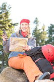 Fotografie Active woman backpack search navigation map