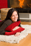 Home living happy woman lying by fireplace