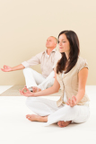 Casual business yoga woman meditating colleague