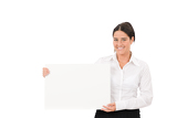 Happy businesswoman holding aside empty banner