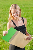 Surprise envelope young businesswoman sunny meadow