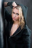 Blond sexy boxing woman in black portrait