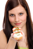 Healthy lifestyle - woman enjoy caprese sandwich