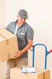 Fotografia Messenger mature male courier delivering parcels
