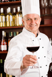 Fotografie Chef cook wine bar hold glass restaurant