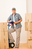 Fotografie Messenger mature male courier delivering parcels