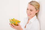 Healthy lifestyle - woman holding bowl with fruit salad