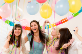 Fotografie Birthday party celebration - four woman with confetti have fun