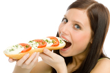 Healthy lifestyle - woman eat caprese sandwich