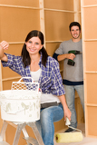 Photo Home improvement: young couple fixing new house