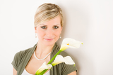 Portrait of romantic woman hold calla lily flower