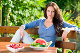 Fotografie Garden terrace beautiful woman fresh summer fruit