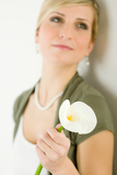 Calla lily flower romantic woman in background