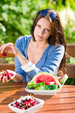 Fotografie Fresh cherries melon woman garden summer terrace