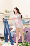 Photo Student girl fitting trousers in the morning