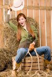 Fotografie Crazy young cowgirl horse-riding country style