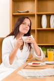 Fotografie Breakfast at home dreamy woman with coffee