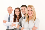 Fotografie Business team happy standing in line portrait