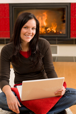 Fotografie Home living happy woman work computer fireplace