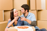 Fotografie Moving new home young couple have lunch