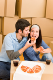 Moving new home young couple eat pizza