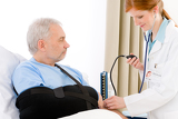 Photo Hospital - doctor check blood pressure patient