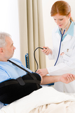 Hospital - doctor check blood pressure patient